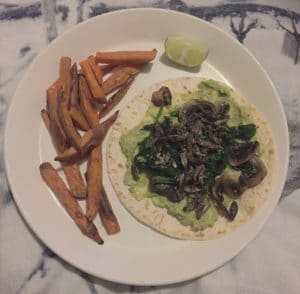avocado and crickets on a warm tortilla with mushrooms