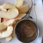almond butter mixed with cricket powder on apples for healthy snack