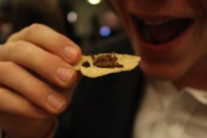 entomo farms whole roasted crickets on chips at the commerce and engineering environmental conference at queens university in ontario